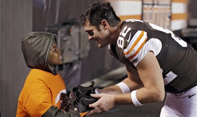 Cleveland Browns tight end Gary Barnidge (82) hands his shoes to Devon Aire after the Browns' 24-18 win over the Baltimore Ravens in an NFL football game Sunday, Nov. 3, 2013, in Cleveland. Barnidge caught a 4-yard touchdown pass in the game. (AP Photo/Mark Duncan)